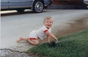 Sprinkler Daddy's Sean Stefan playing with sprinklers at about age 3